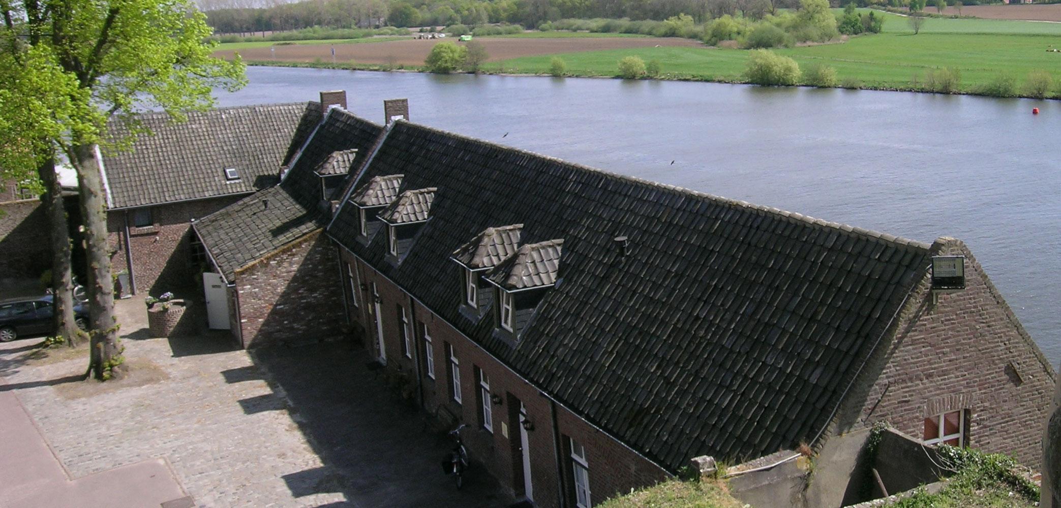 Foto header met het uitzicht over de Maas in Kessel